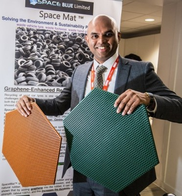 Dr Vivek Koncherry holding hexagonal version of his SpaceMat