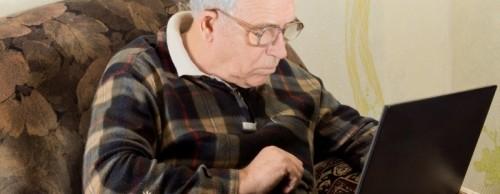 Older man using a laptop