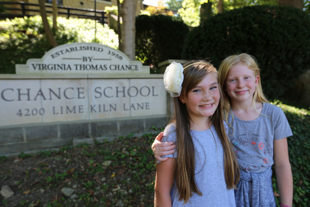 Two girls standing outside of Chance School