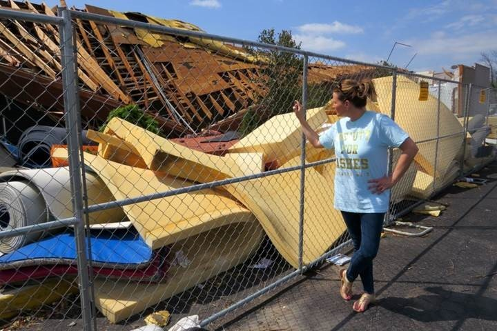 Jennifer Patterson viewing the remains of Aim High Academy's practice center following a tornado.