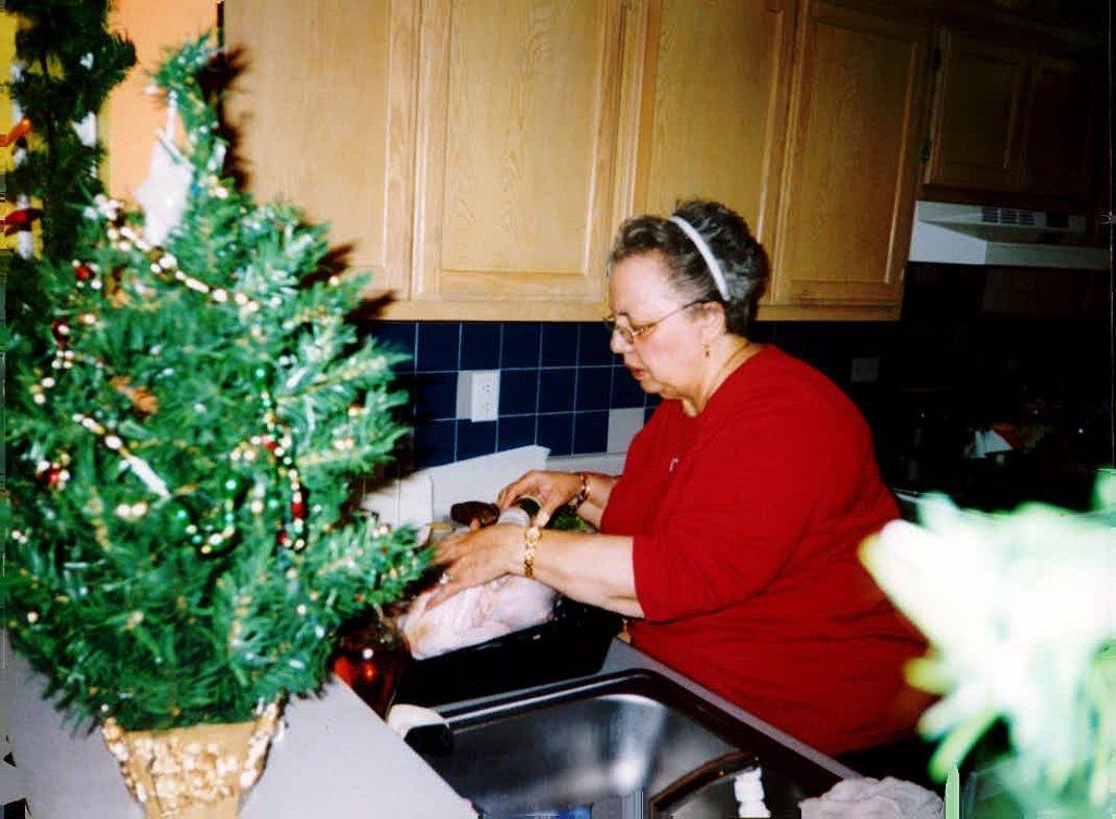 Alejandra's friend's grandmother cooking in the kitchen.