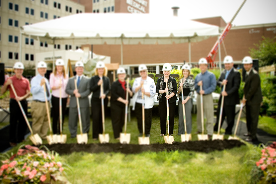 people lined up with shovels for the Groundbreaking