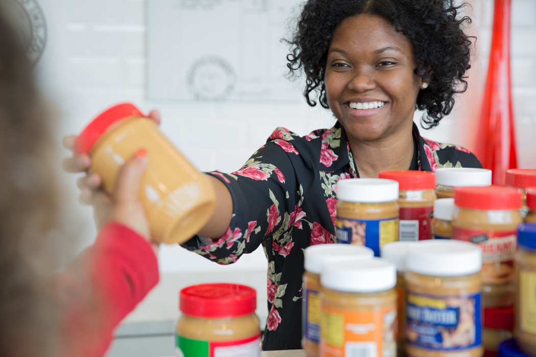 Kandace Waddy adding a jar of peanut butter to the collection.