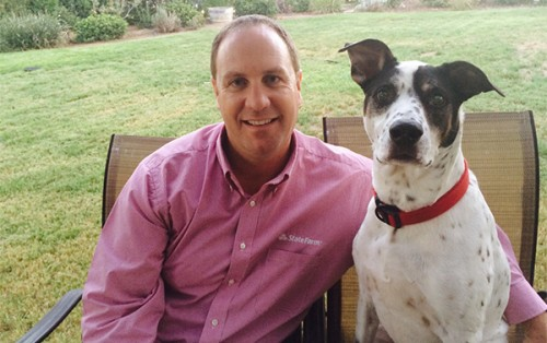 State Farm agent Andy Popka with a dog