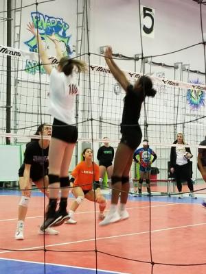 Kayanna playing volleyball