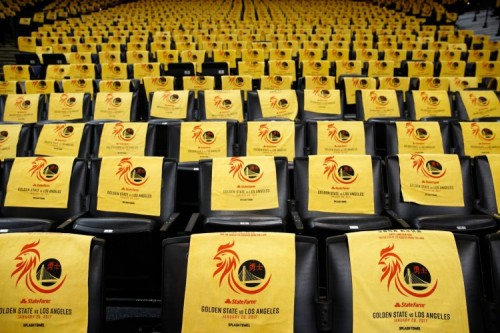 Lunar New Year Rooster Splash towels await fans at the Golden State Warriors game January 28, 2017