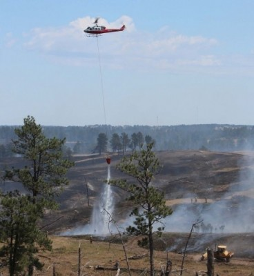 Helicopter Dumping Buckets of Water on the Wildfire