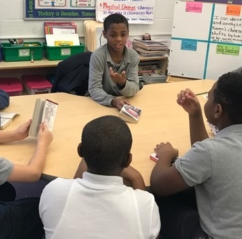 Student Antonio King meets with the book club at Amidon-Bowen Elementary School. The club is focused on improving literacy and a love of reading.