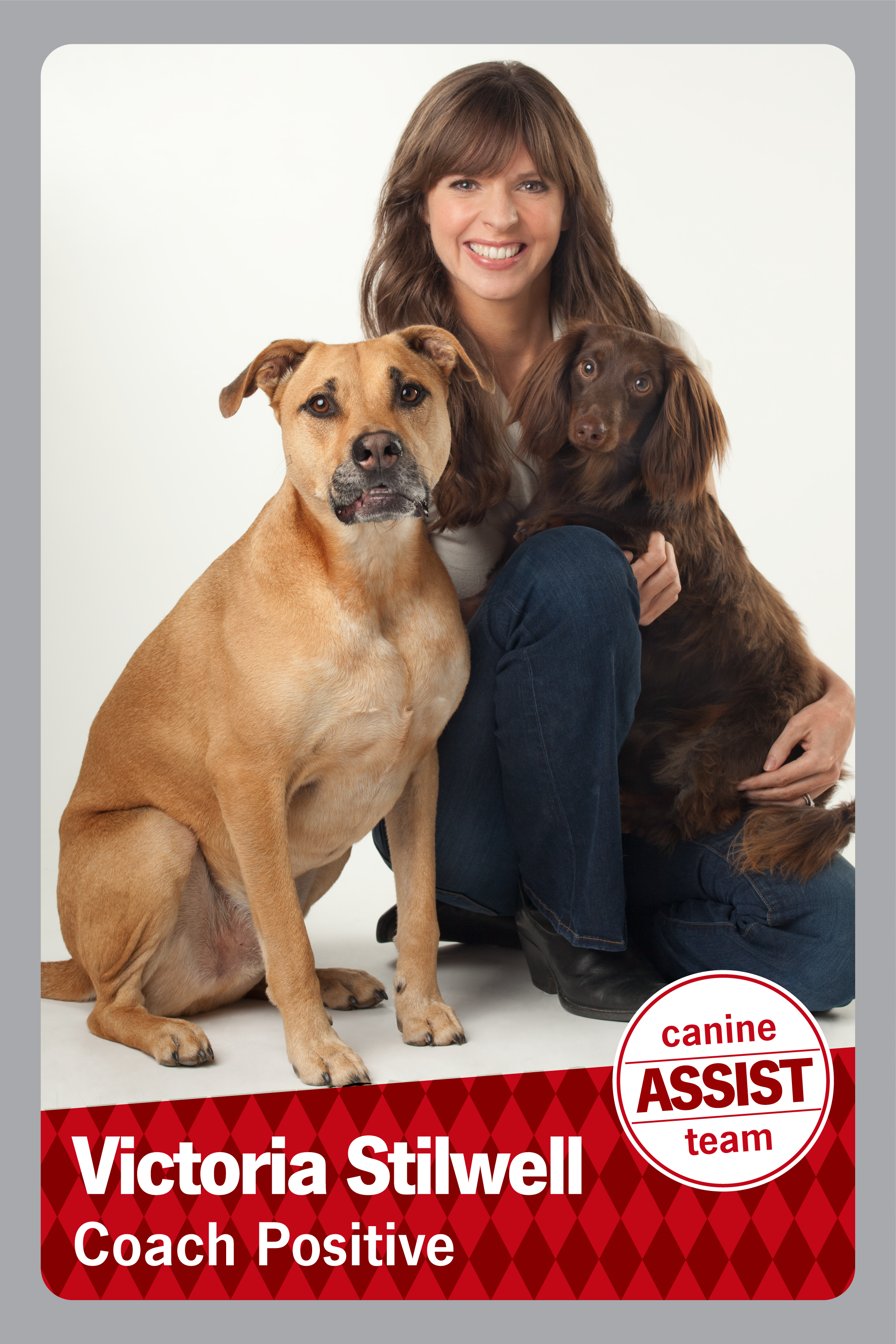 Victoria Stilwell Coach Positive, a picture of a woman with two dogs.