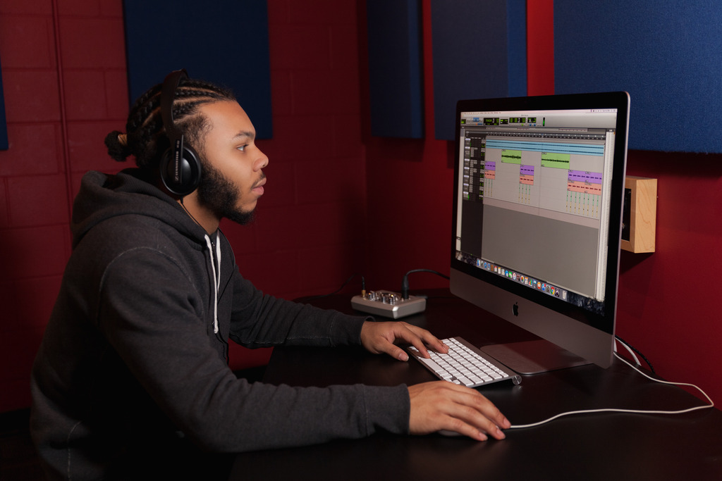 Student on Computer, editing music