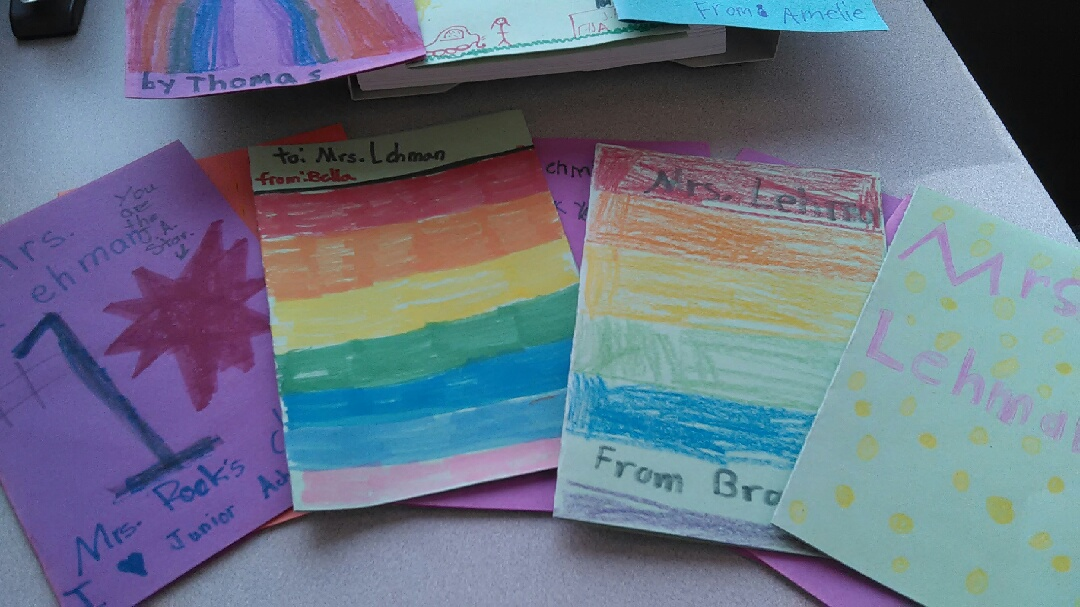 an array of hand made cards on colored paper and colored decorations on the front of the cards addressed to Mrs. Lehman