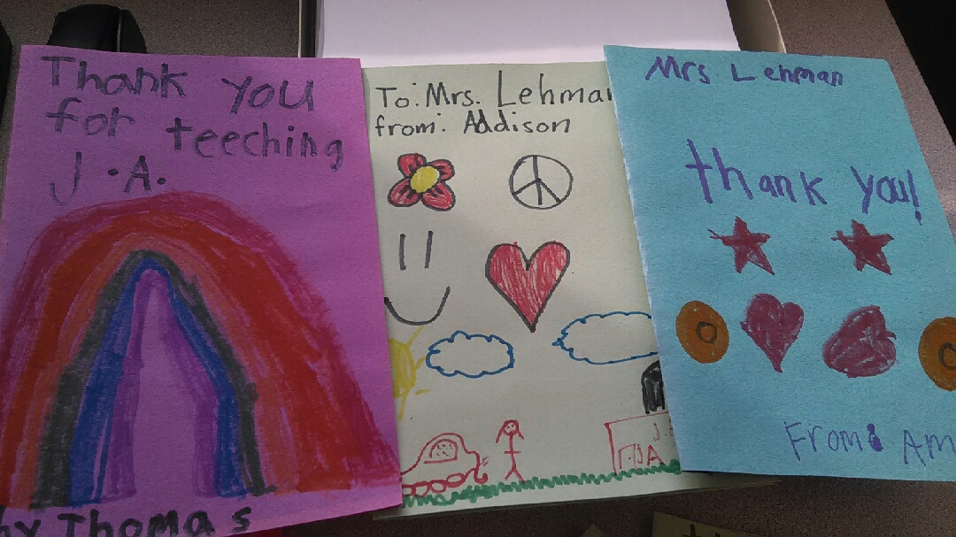 hand made thank you cards made my children on colored paper addressed to Mrs Lehman with picture drawn on the card of rainbow, flowers and hearts