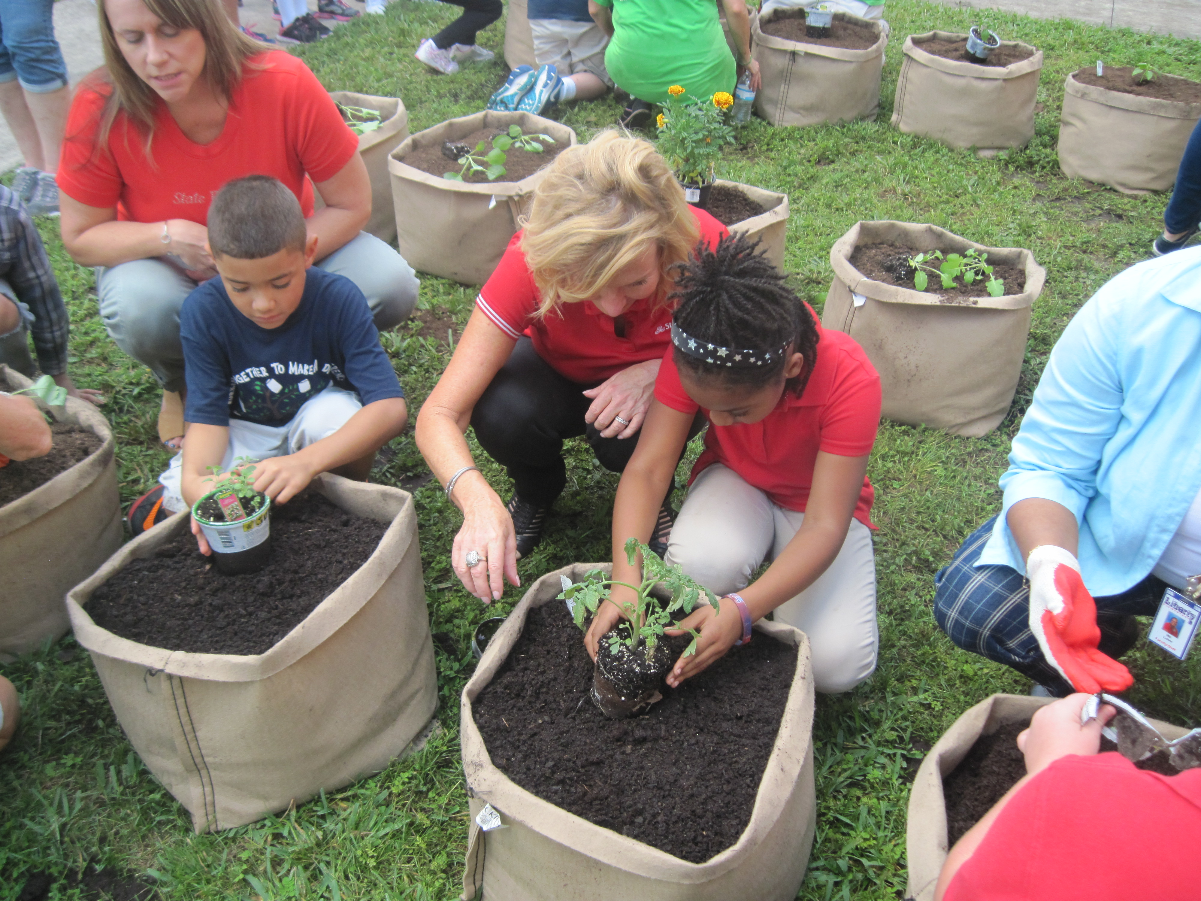 State Farm agents help students plant