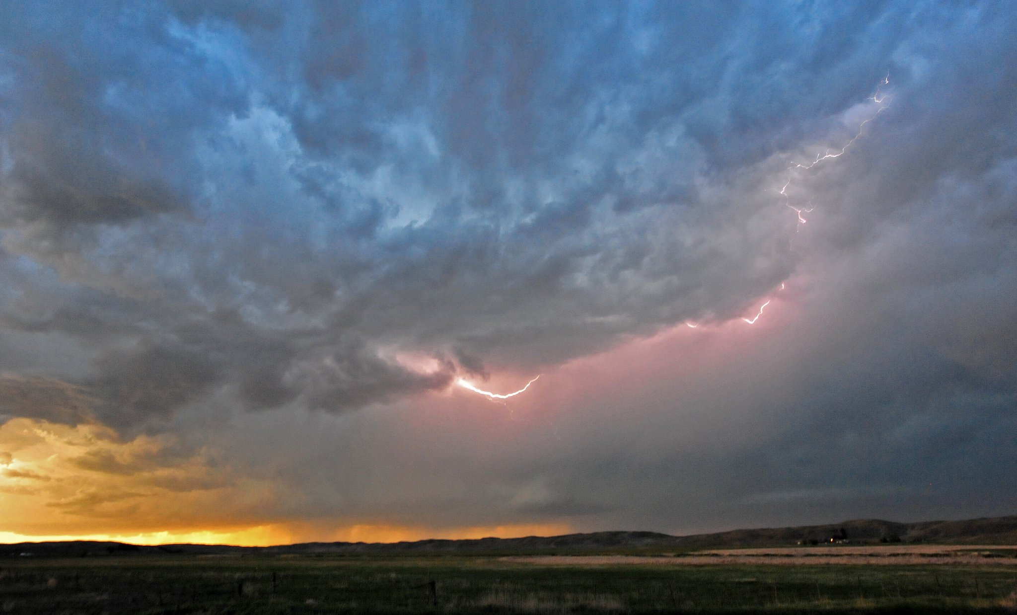 clouds and lightning approach on a horizon
