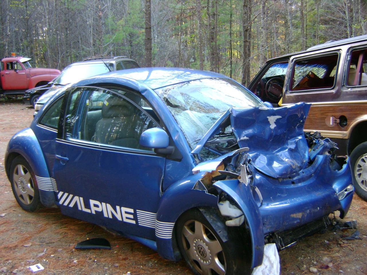 Blue Volkswagon bug smashed up due to a car crash