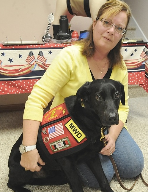 Tracy Spader, founder of the K9 Defender Fund takes time out for a photo with her four-legged first responder Jig.