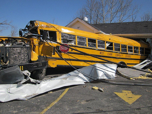 school bus among the debris of the tornado