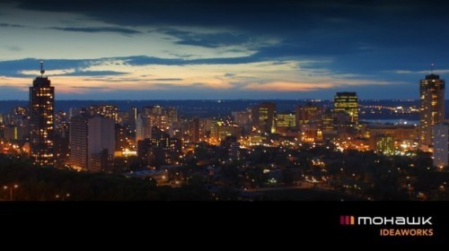 evening skyscape of Hamilton with Ideaworks logo
