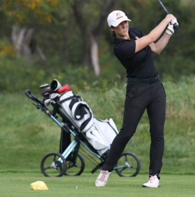 Nicole Brusich golfing on the green for GSU