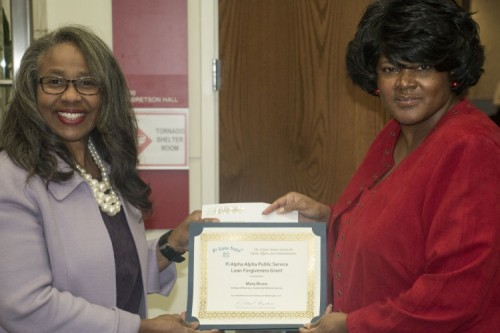 Dr. Mary Bruce and Ms. Tasha Baker hold up the grant certificate for a $500 Public Service Loan Forgiveness grant earned by the chapter in 2017