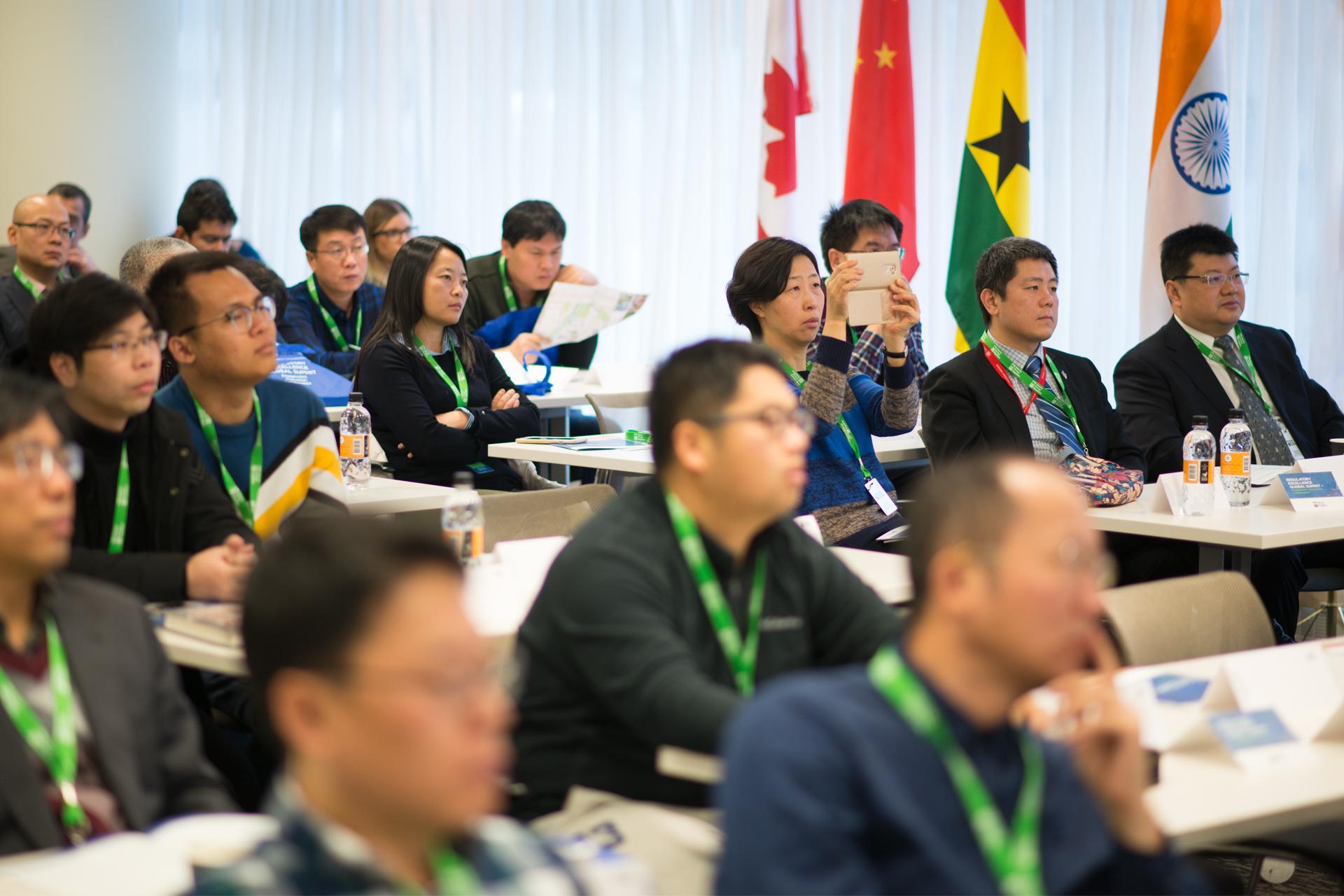 International delegates listen to AER president and CEO Jim Ellis discuss regulatory excellence.