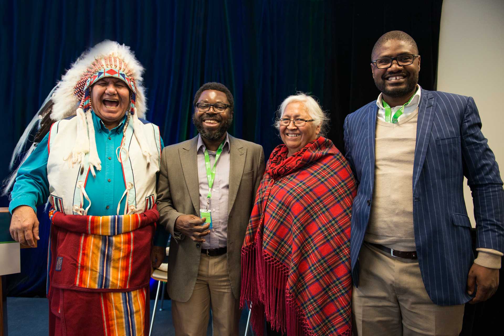Nigerian delegates enjoy a moment with Blackfoot elders Dr. Reg Crow Shoe and Rose Crow Shoe.