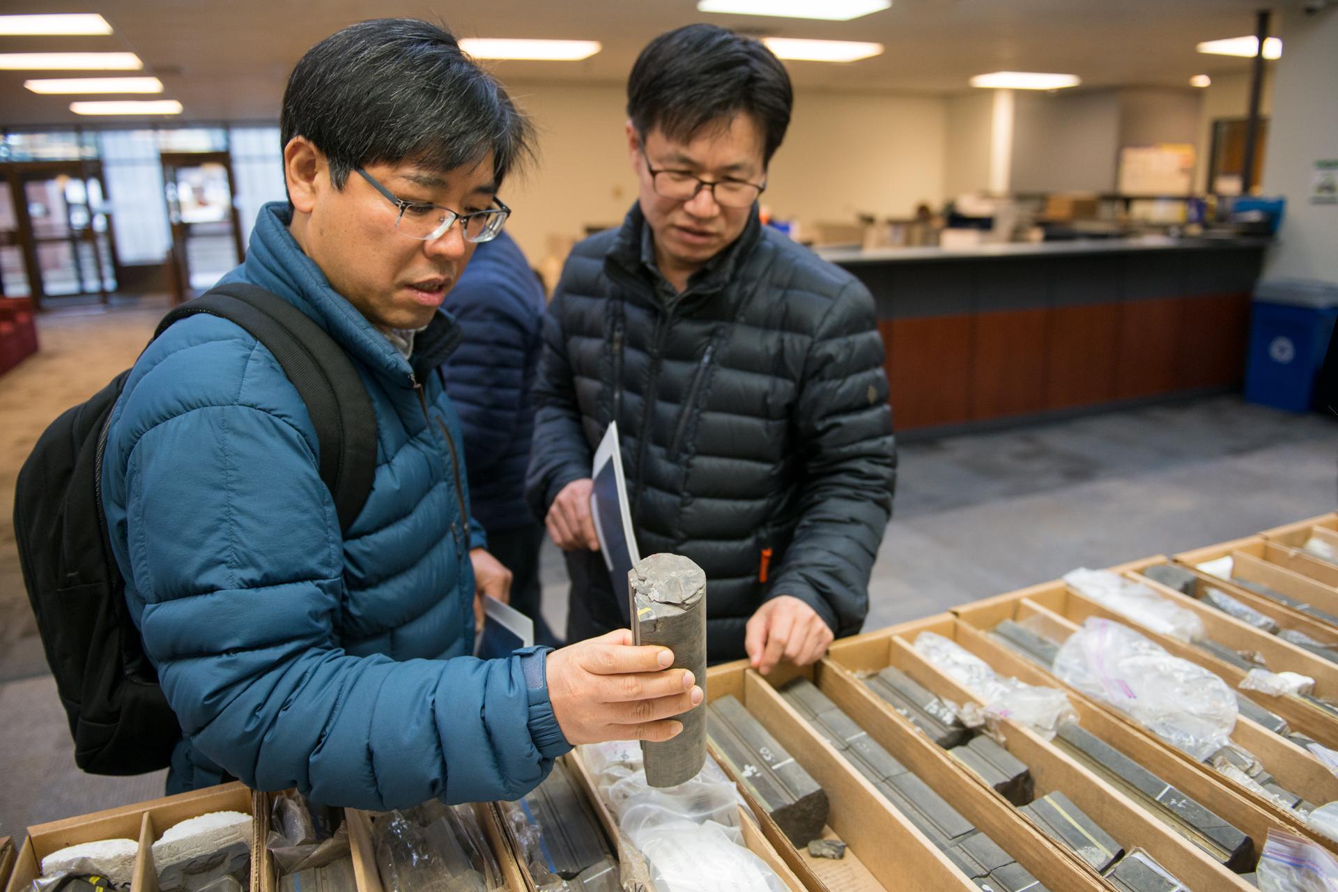 Delegates examine core samples at the Core Research Centre.