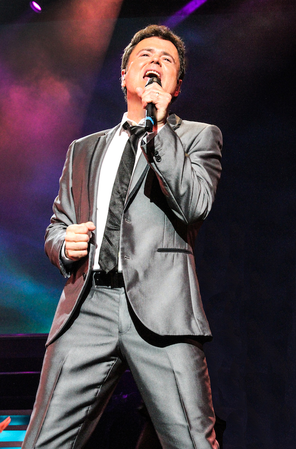 Donny Osmond, singing with microphone
