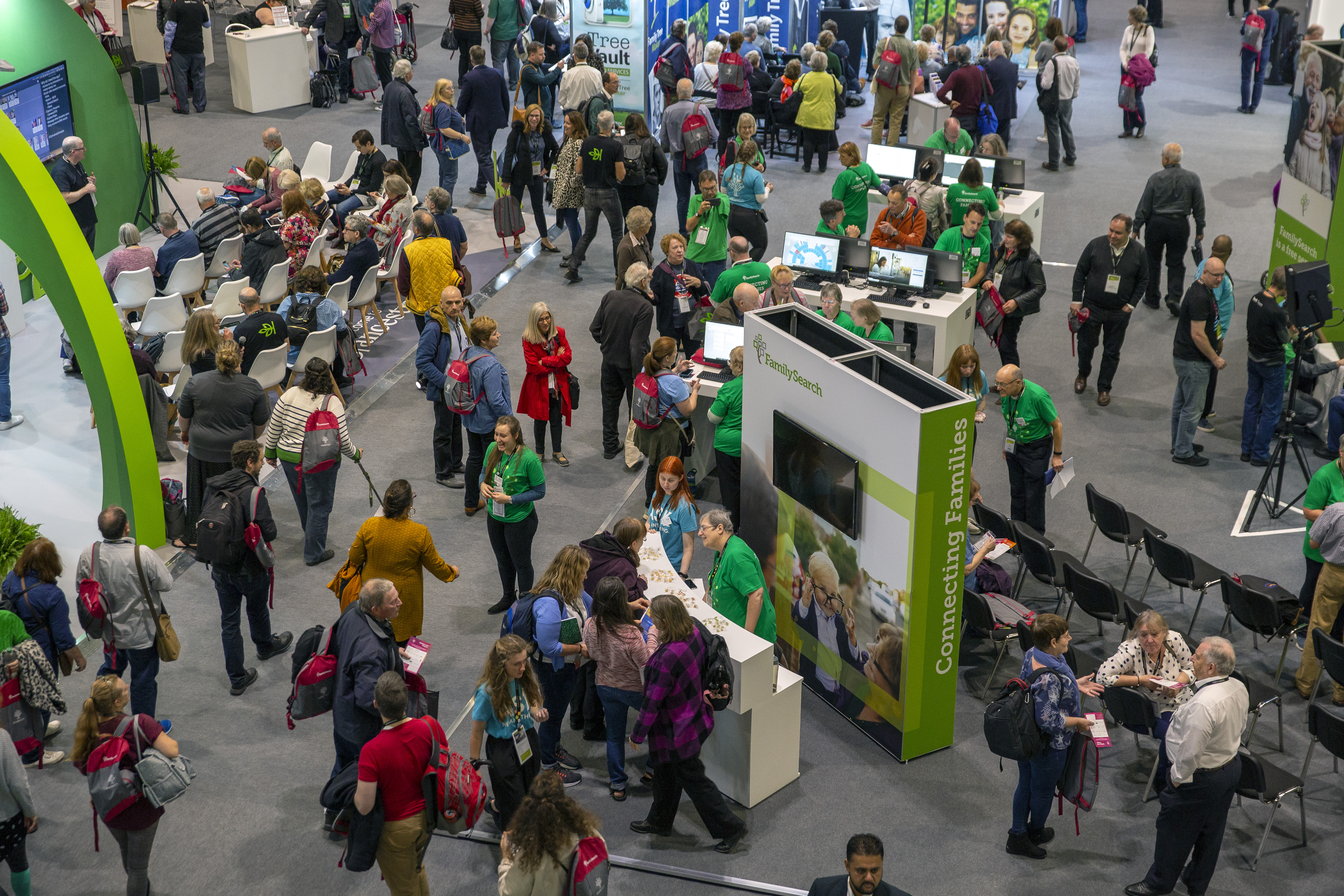 Attendees at RootsTech London 2019 busily explore the many activities and service in the Expo Hall.