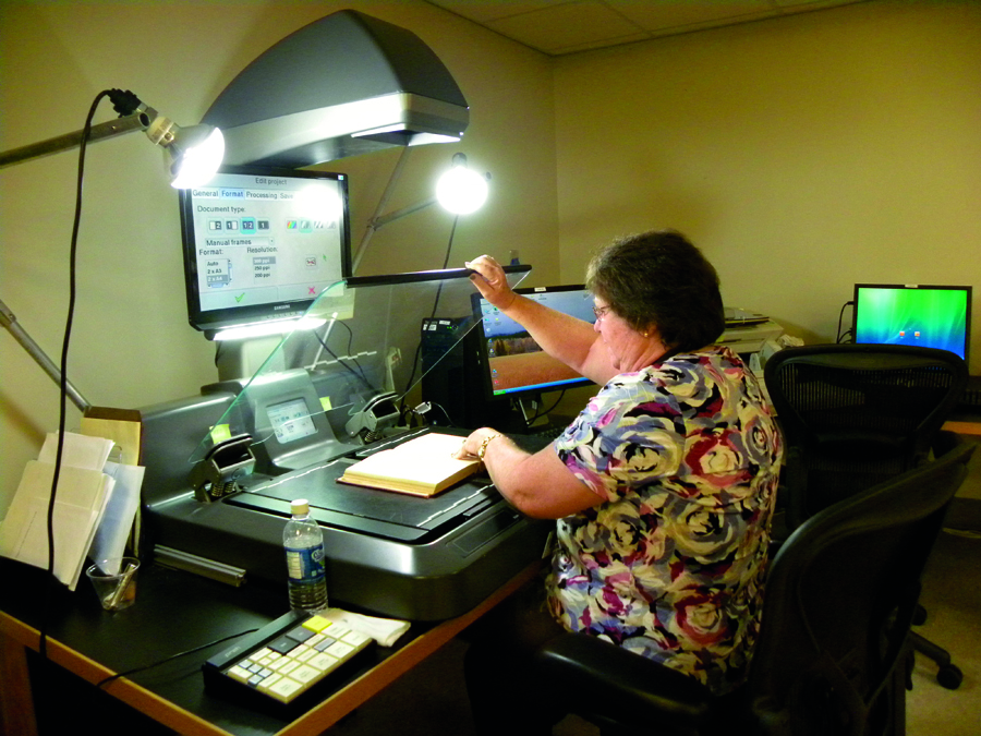 FamilySearch volunteer digitally preserving books for online access.