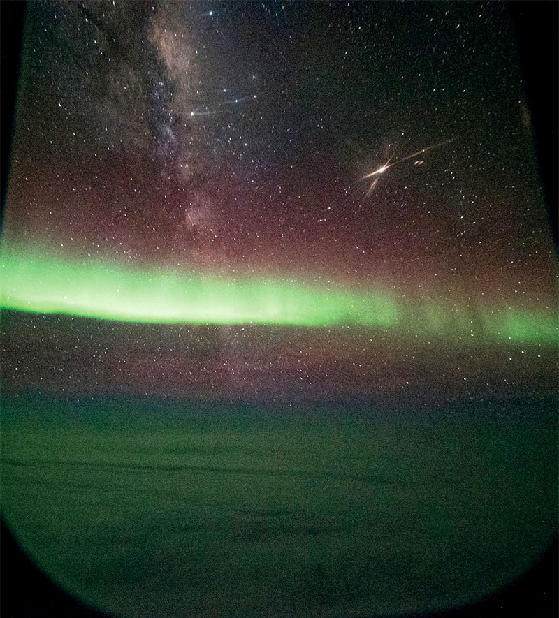 Photo taken through SOFIA's window during an observing flight from New Zealand. Aurora glow green high in Earth's atmosphere in a region called the thermosphere. The Milky Way (left) and Mars (right) shine brightly above it. Credit: NASA/SOFIA/Ian Griffin