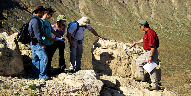Dr. David Kring with students at Barringer Meteorite Crater, Arizona (aka Meteor Crater)