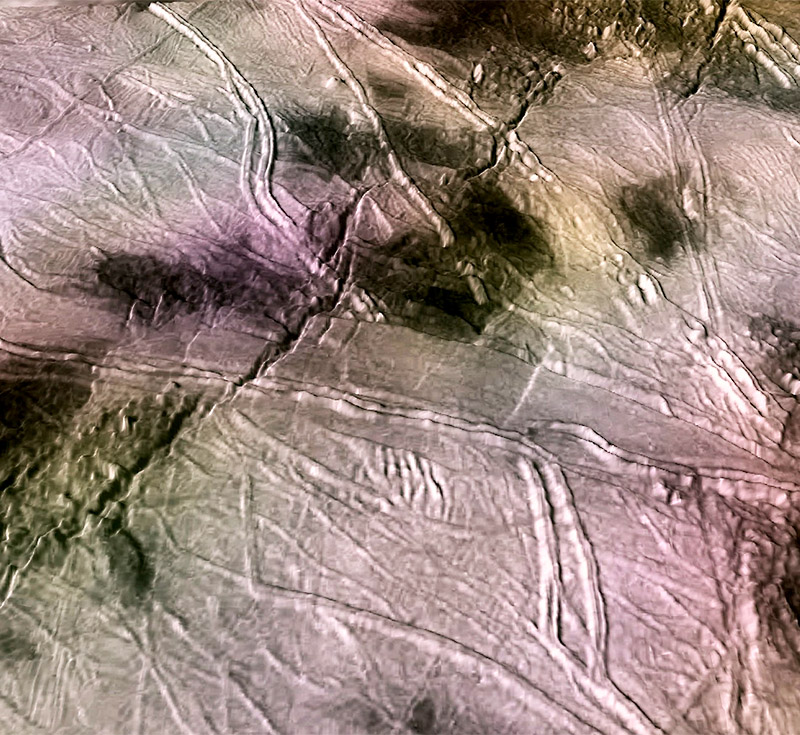 Perspective views of fractures on the surface of Europa formed during true polar wander. The large cracks crossing the scene from left to upper right are ~3 kilometers (1.9 miles) wide and 200 meters deep. The double ridges crossing the scene are similar in width. Credit: P. Schenk/ USRA/LPI.