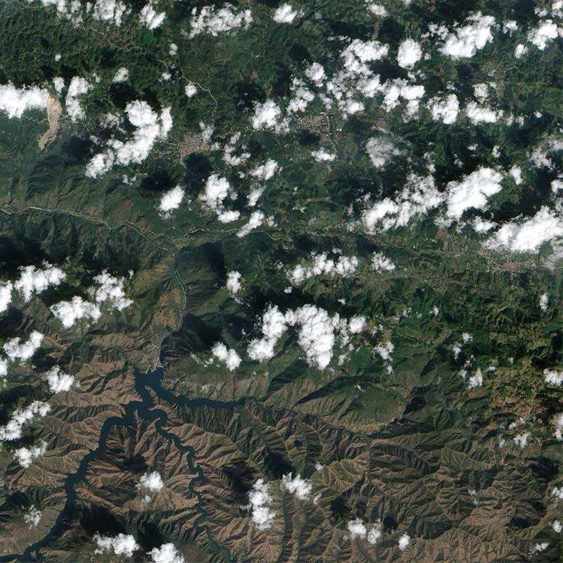 On January 4, 2009, a mountainside in northern Guatemala suddenly collapsed, sending thousands of tons of rock and debris downhill and burying a nearby road. The event occurred in the state of Alta Verapaz, some 200 kilometers (124 miles) north of Guatemala's capital city.  Credit: NASA image created by Jesse Allen, using EO-1 ALI data provided courtesy of the NASA EO-1 Team. Caption by Michon Scott.