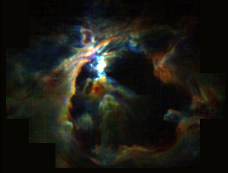 The powerful wind from the newly formed star at the heart of the Orion Nebula is creating the bubble (black) and preventing new stars from forming in its neighborhood. At the same time, the wind is pushing molecular gas (color) to the edges, creating a dense shell around the bubble where future generations of stars can form. Image credits: NASA/SOFIA/Pabst et. al