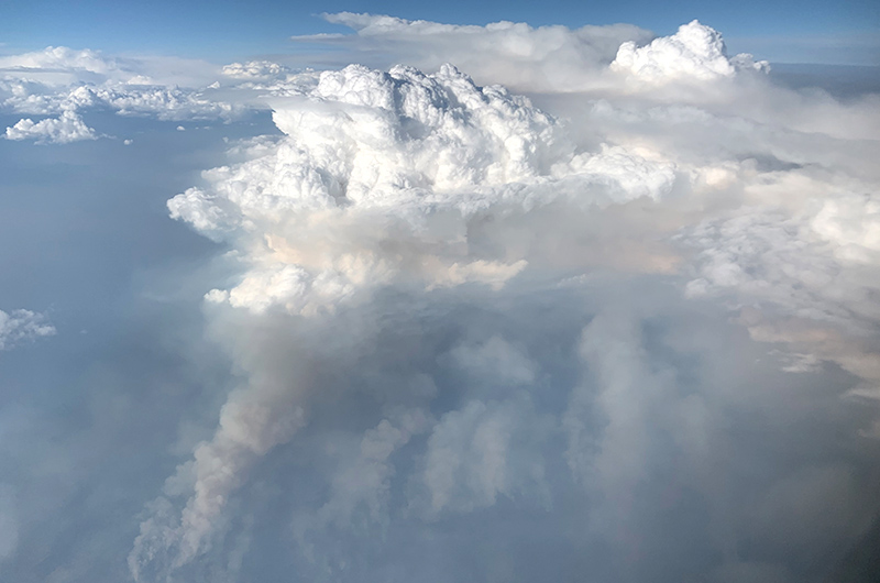"""PyroCb are like """"large chimneys """" transporting smoke into the lower stratosphere. NASA Earth Observatory image by Joshua Stevens, using Landsat data from the U.S. Geological Survey. Photograph by David Peterson (U.S. Naval Research Laboratory)."""
