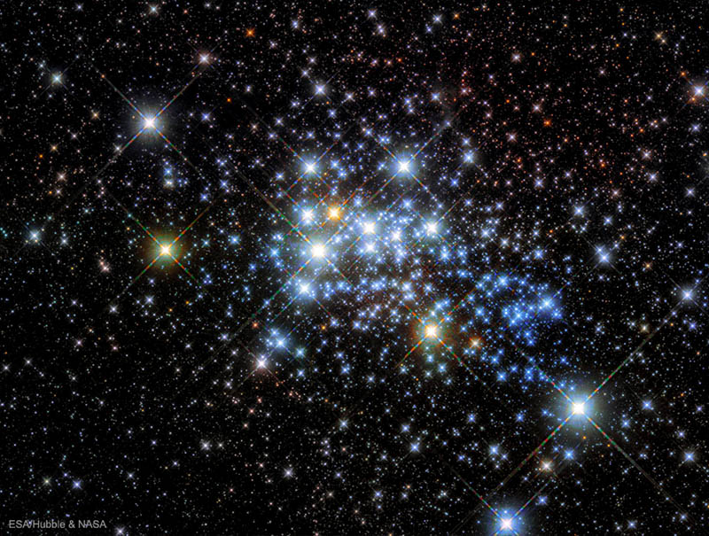 Image of young star cluster Westerlund 1 taken by the Hubble Space Telescope toward the southern constellation of the Altar. Westerlund 1 is home a variety of the largest and most massive stars known, including red, yellow and blue supergiants as well as an exotic object known as a magnetar. Westerlund 1 is relatively close-by for a star cluster at a distance of 15,000 light years, giving astronomers a good laboratory to study the development of massive stars. Image Credit: ESA/Hubble/NASA