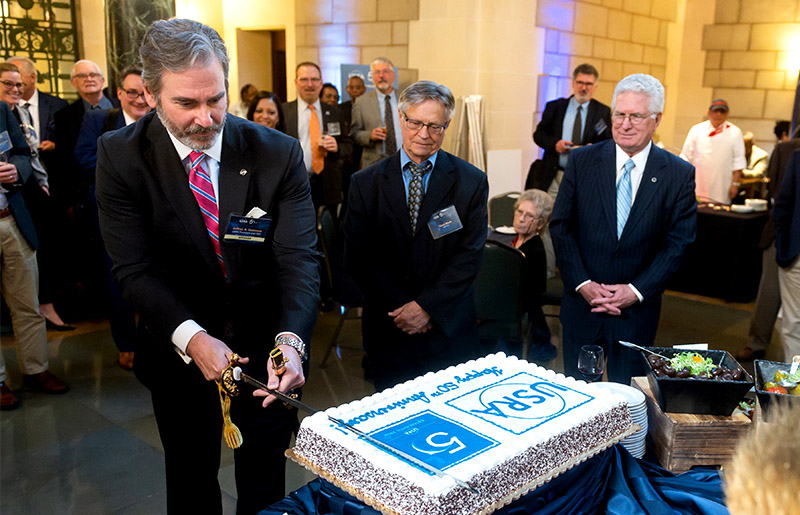Cake cutting with Jeffrey A. Isaacson, David Black, and Bill Ballhaus