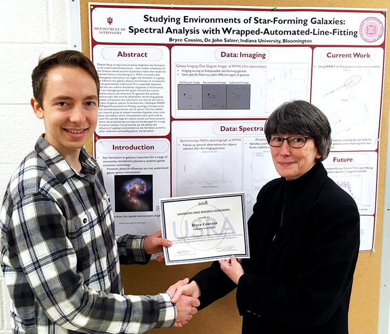 Bryce Cousins (left) receiving the USRA award from Prof Eileen Friel (COI Rep, Aerospace Engineering, Indiana University)