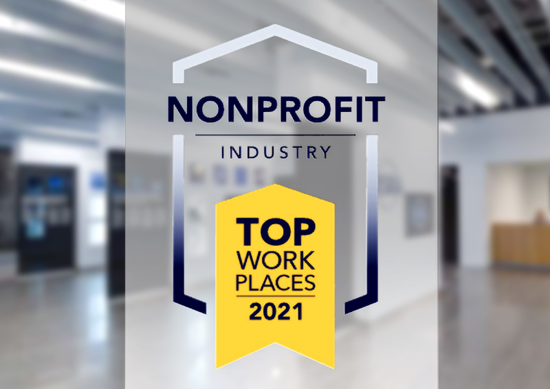 2021 Nonprofit industry top work places graphic overlaying USRA lobby