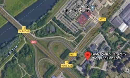 De Fontys-campus (rechtsonder) ligt vlak bij de Maas. - foto Google Maps