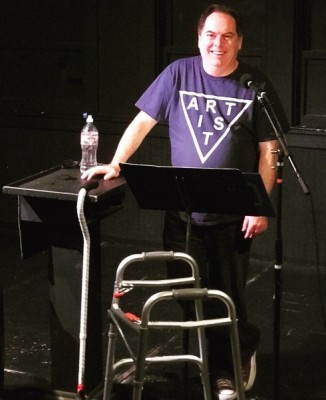 """Michael Shutt performing the first reading of his solo show, """"A Lesson in Swimming."""" Photo courtesy of Michael Shutt.."""