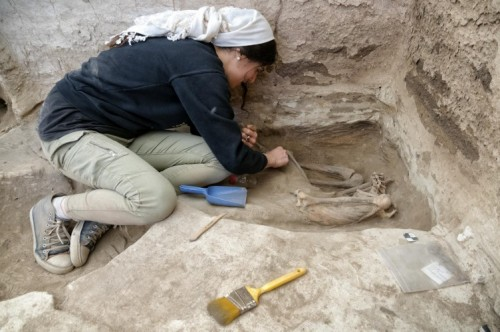Nada Elias excavating an adult skeleton.