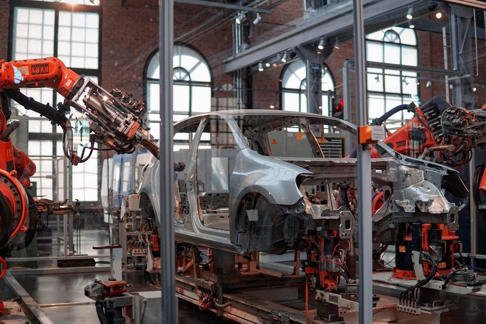 Photo of robot making car.