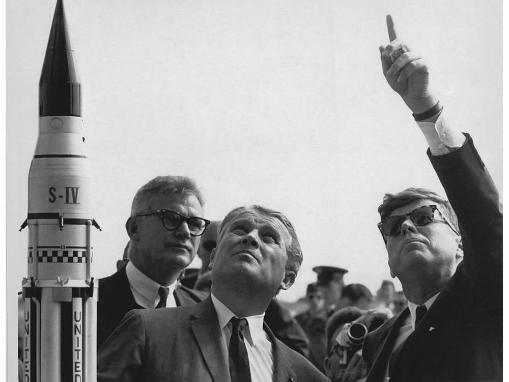 Wernher von Braun (center) explained the Saturn Launch System to President John F. Kennedy.