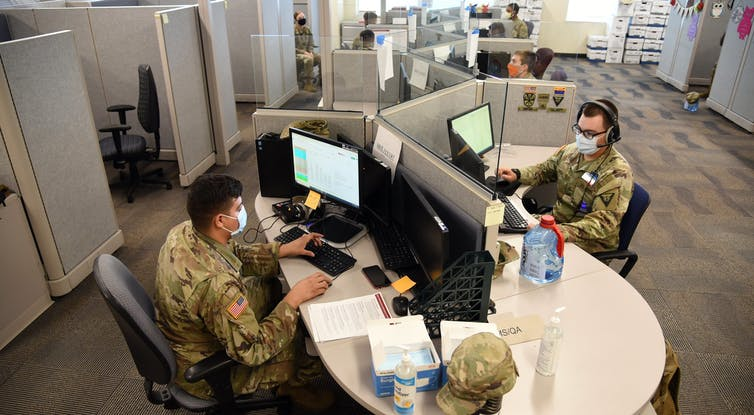 Arizona National Guard members conduct exposure notification calls.