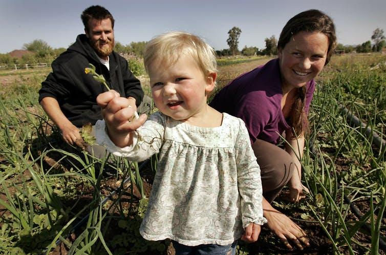 Photo of family in farm field.