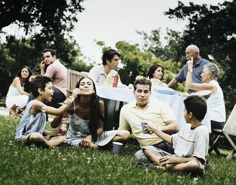 Family outdoors having fun.