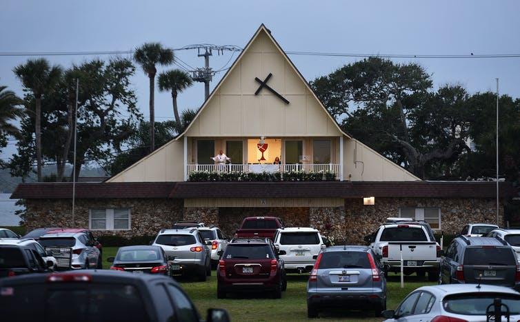 Car horns mark 'amens' at drive-in church services, such as this one in Daytona Beach, Florida.