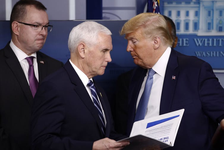 Pence and Trump attend a coronavirus task force briefing.
